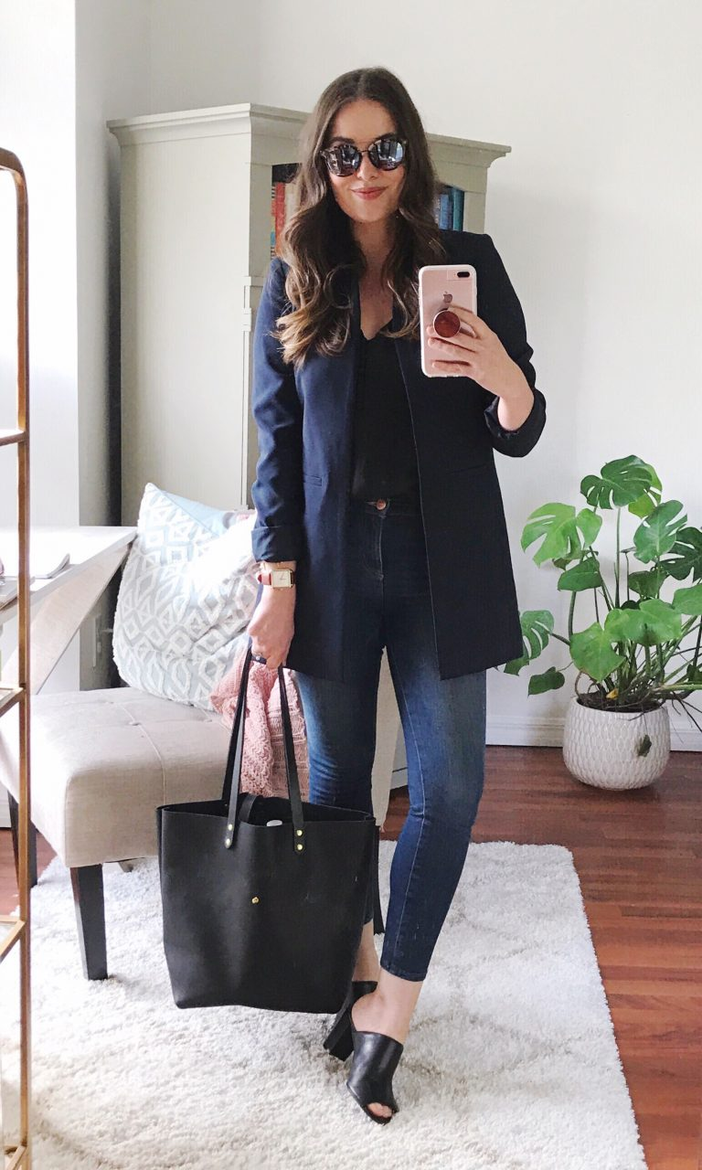 Style blogger wearing long navy blazer and dark skinny jeans with black mules and a Neva Opet leather tote