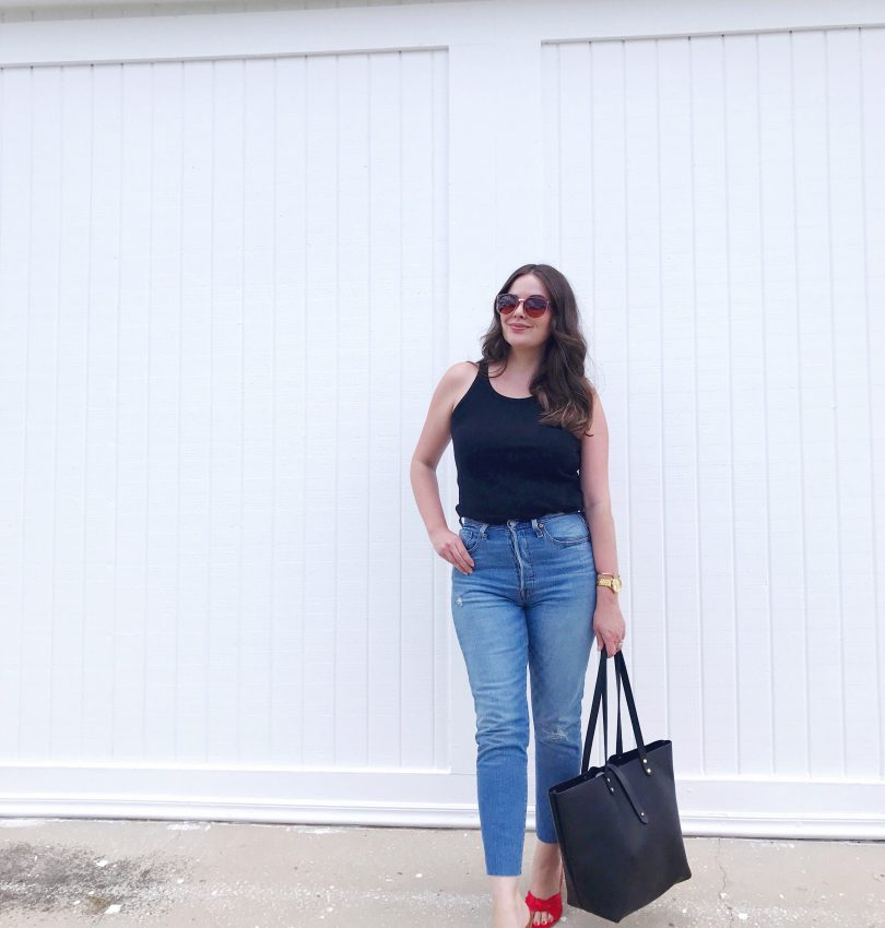 Style blogger wearing Levi's 501 skinny jeans with a black tank and red LOFT satin knot slide sandals