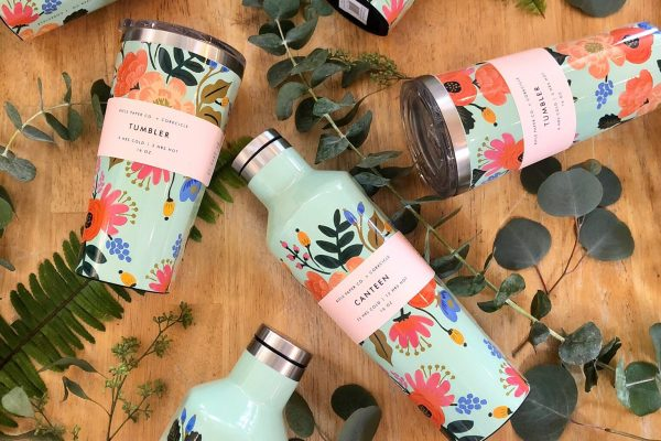Rifle Paper Co. x Corkcicle 'Lively Floral' tumbler flat lay with fresh spiral eucalyptus