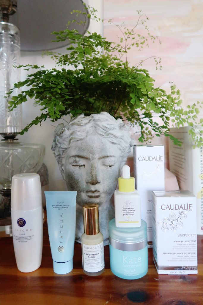 Sephora VIB Sale Top Skin Care: Tatcha Camellia Cleansing Oil, Tatcha Silken Pore Perfecting Sunscreen, FARMACY Farmacy Honeymoon Glow AHA Resurfacing Night Serum with Echinacea GreenEnvy, Drunk Elephant Marula Oil, Kate Somerville Nourish Moisturizer, Caudalie Vinoperfect Radiance Serum, Caudalie Vinoperfect Concentrated Brightening Essence