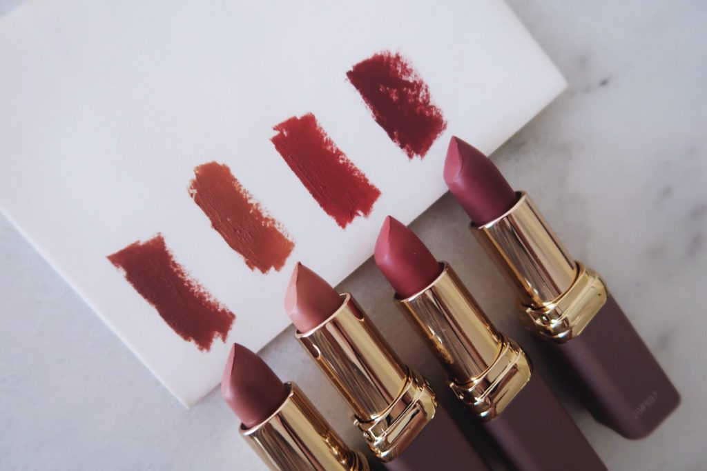L'Oreal Colour Riche Ultra Matte Lipstick swatches on paper in natural daylight. From left to right: All Out Pout (978), Utmost Taupe (983), Passionate Pink (977),