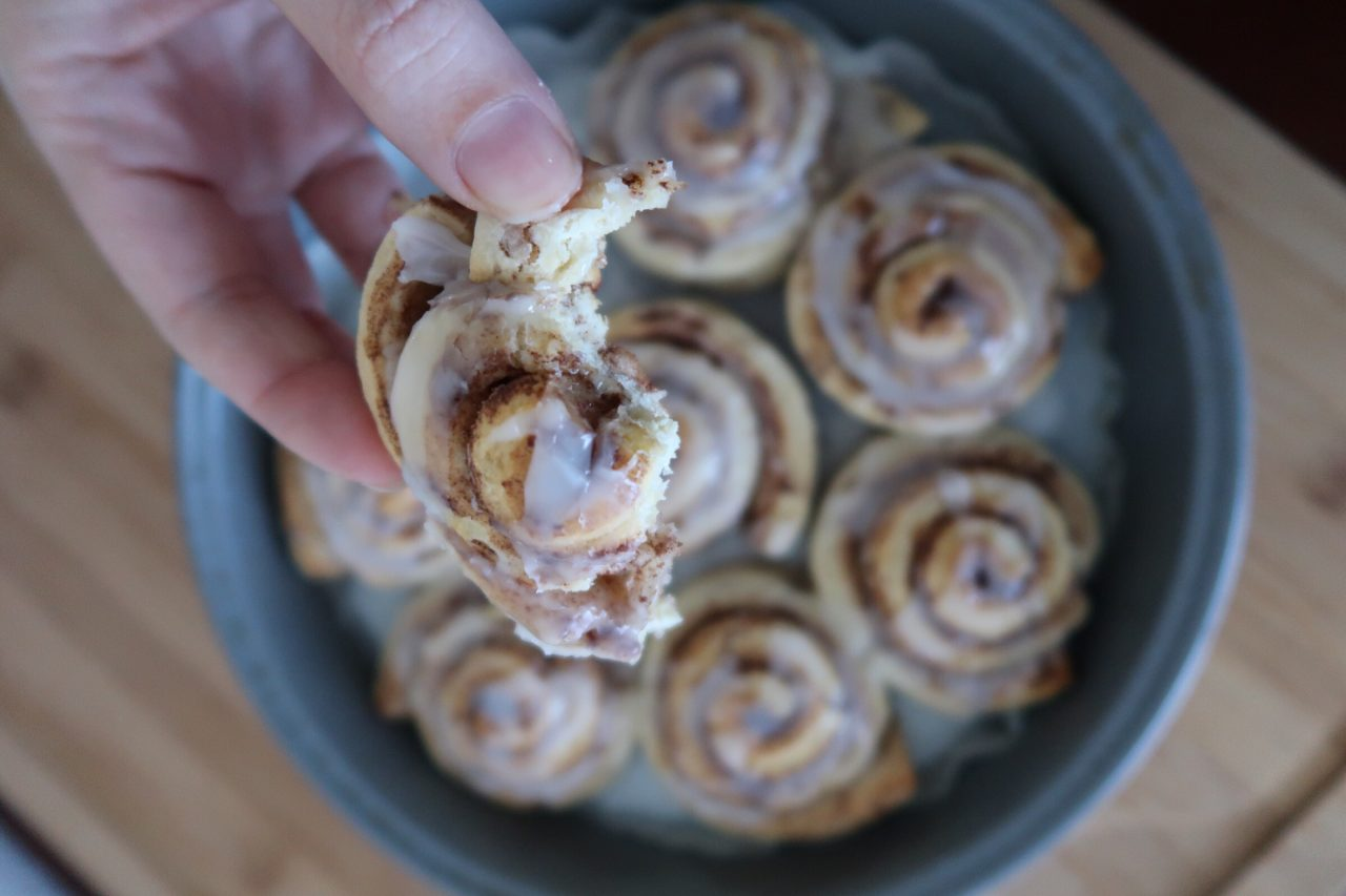 Round pan of break-and-bake cinnamon rolls fresh out of the oven