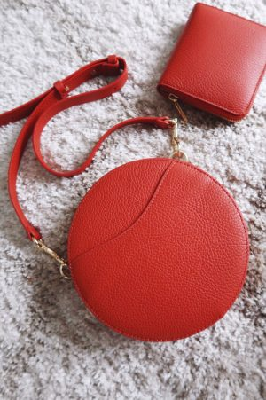 Cuyana Mini Circle Bag in 'blood orange' leather with matching small zip around wallet