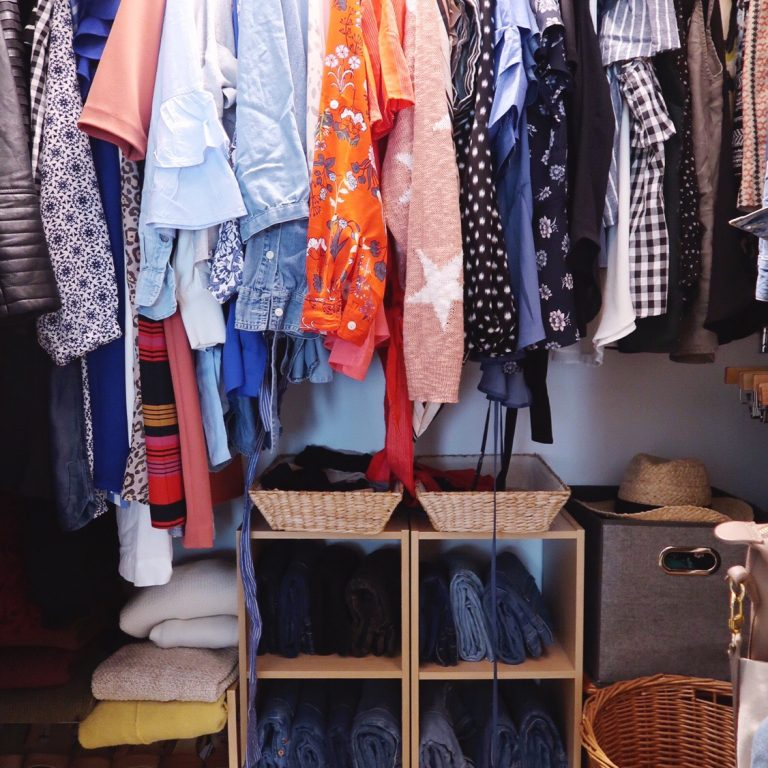 Closet organized for spring with woman's clothing, shoes and accessories