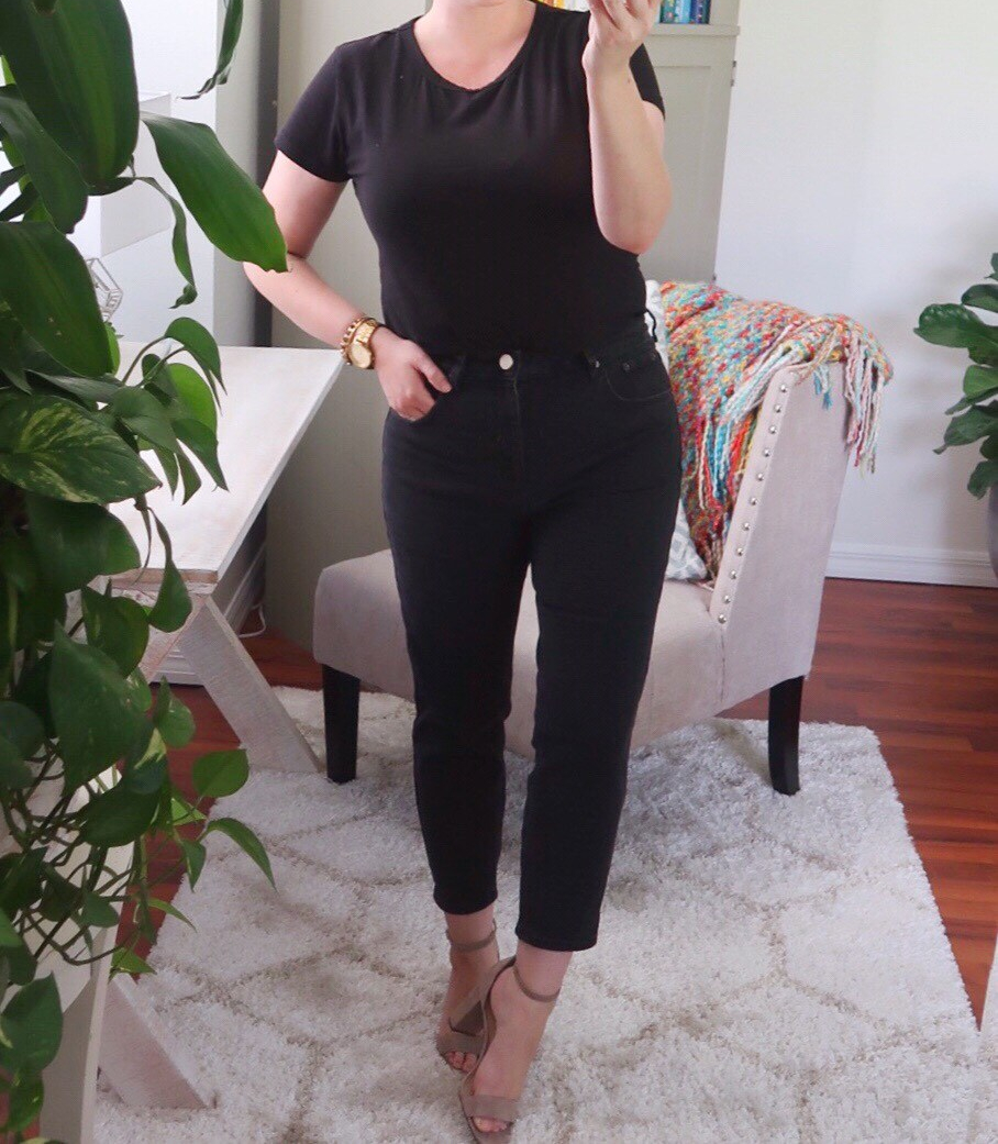 Style blogger wearing an all-black casual outfit with H&M Conscious cotton tee and ASOS Petite Farleigh Jeans in washed black.