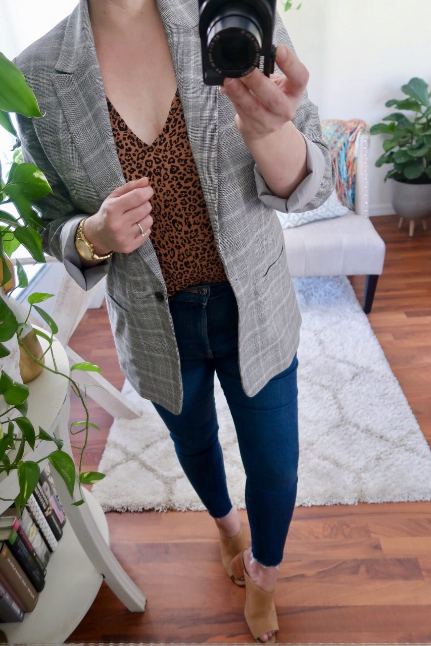 Style blogger wearing a gray plaid blazer over an animal print tank and Everlane skinny jeans