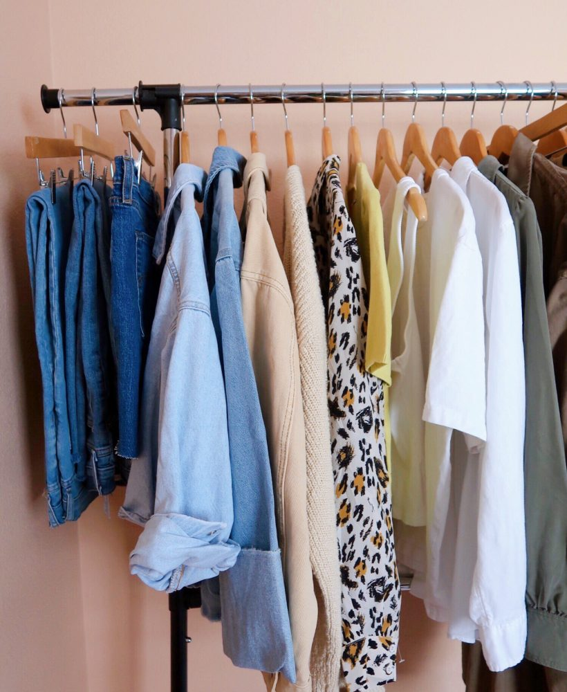 summer capsule wardrobe hanging on a clothing rack