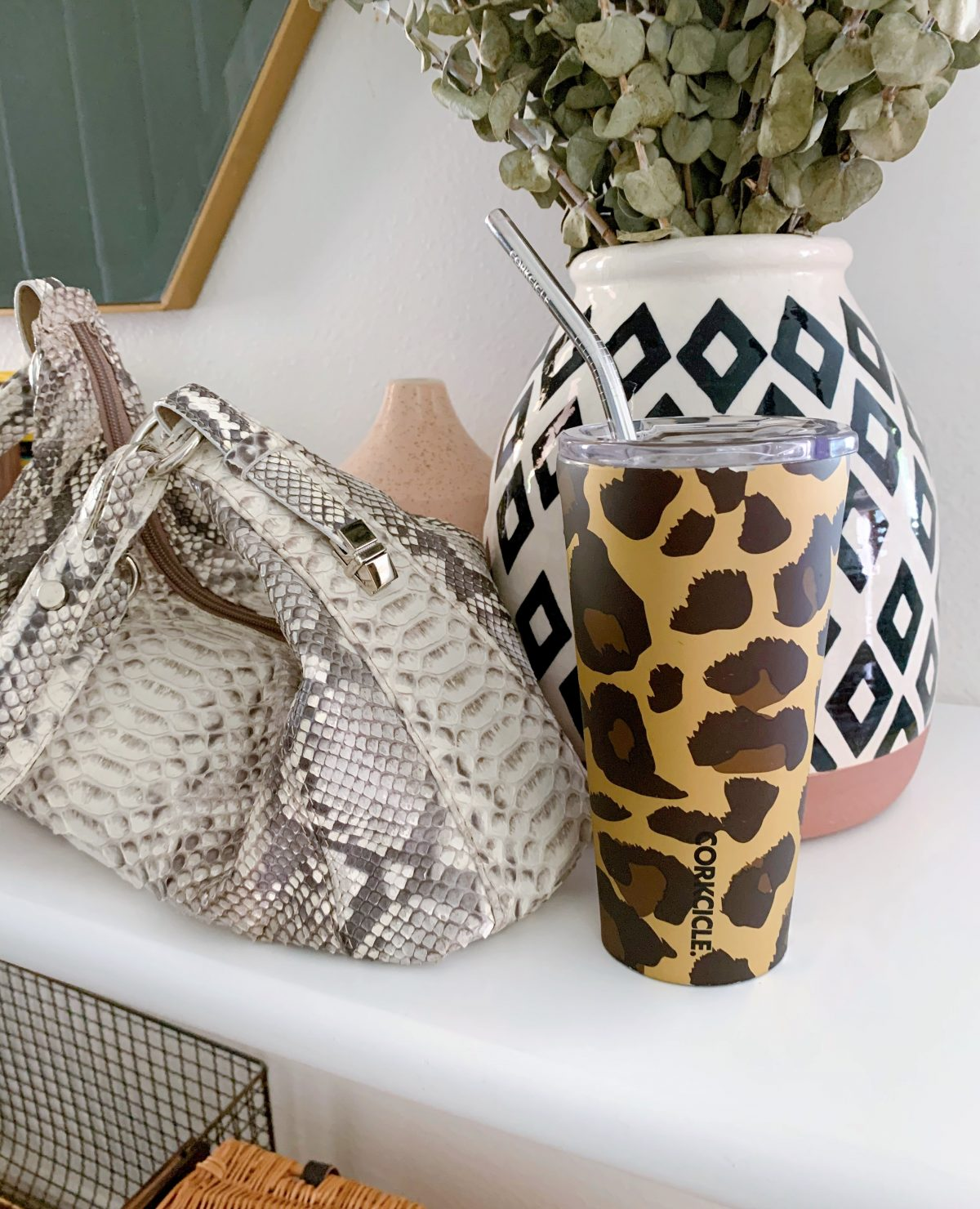 My favorite super easy iced coffee recipe in a Corkcicle leopard tumbler